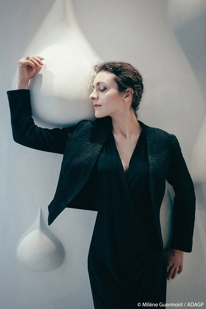 Milène Guermont, photographed by Sokorina Lena, in front of the Polysensual Concrete MINI AGUA at the French Pavilion of the International Exhibition